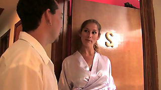Seductive masseuse gives relaxing massage to regular client in massage parlor