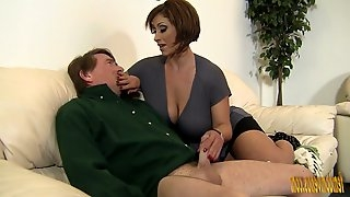 Mega busty mistress Kyle Stone gives boots job and boobs job to her submissive