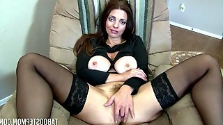 Sultry brunette with big tits, Mindi Mink likes to spread up wide to show her trimmed pussy